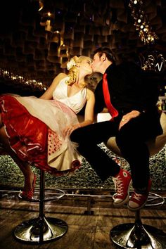 I love the deep vneck of the dress w/ the red tulle underneath... also the matching red shoes on the groom <3