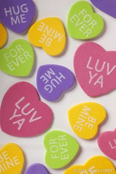 For a fun craft with kids, make your own conversation heart decorations for Valentine's Day.