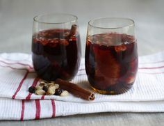 {Tipsy Christmas Cheer} Glogg for everyday joy | Ingredients: 1 bottle    100 cl water  2 cm fresh ginger  2 cinnamon sticks  6 cardamom pods  6 cloves    4 cups fruit juice (unsweetened) we used blackcurrant sweetened with apple and grape  3 tbsp honey (if your fruit juice tastes sour)  50 g almonds (blanched)  50 g walnuts  100 g raisins  1 orange (thinly sliced)