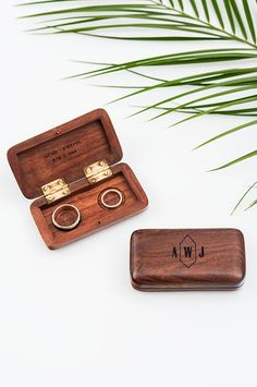 An original alternative to a classic ring cushion, this rustic, vintage inspired, miniature wooden box has been designed to carry both wedding rings and can slip into an inside pocket with ease. Hand carved from polished dark wood it includes a magnet clasp to help secure your precious rings. Personalised with engraved sentiments and a rustic garland design, this tiny box is heirloom quality and will be a cherished keepsake from your day.