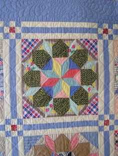 Close-up of 1940's quilt block, finished and quilted by Karen A. Parker at Sew Specialties