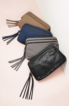 Perfect for an on-the-go lifestyle! These crossbody bags from Treasure&Bond featture 3 graduated, spacious compartments, tassel trims, and an optional chain-link-and-leather strap.
