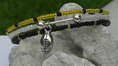 Check out this item in my Etsy shop https://www.etsy.com/listing/475820389/steeler-nation-fan-bracelet
