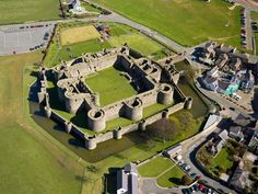 Beaumaris on the isle of Anglesey, Wales. The most impressive example of a concentric castle in the world. Aerial view reproduced under the UK open government license.