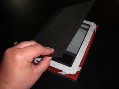Instead of spending money on a case for your new nook or ereader, try to reuse a book.