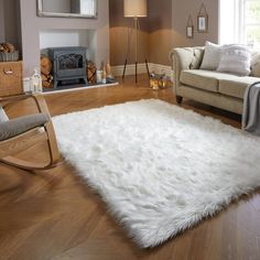 Stylishly designed in natural tones, this amazingly fluffy faux fur rug made from 100% Acrylic will add a cosy, warm and luxurious element to your home décor. A perfect addition to any living space, the deep shaggy pile offers a super-soft warming effect, especially on hard-flooring.Don't forget to buy our anti-slip mat [here], available in a choice of sizes.On opening, flip your rug over and re-roll your rug pile out and leave in a warm room for 24 hours before putting in place. This will help White Fluffy Rug, White Faux Fur Rug, Faux Fur Area Rug, Faux Sheepskin Rug, White Rug, Fluffy Rugs Bedroom, Rugs In Living Room, Living Spaces, Cosy Room