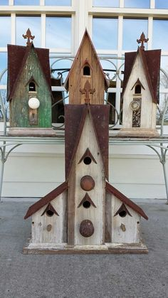 "Rubble birdhouses.  You should have seen the ""before"" shot!! Literally something out of what looked like nothing.  Beautiful work by Jefferson Garvey, Recycling is for the birds!"