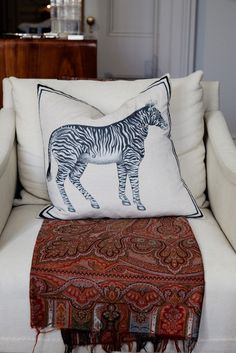 Inside Designer Adam Lippes's New York City Home: We visited his Washington Square Park townhouse a week before his NYFW presentation to snoop through his collections, and pet his two matching labradoodles. -- Zebra pillow and Bohemian blanket.   Coveteur.com