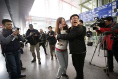 A woman, believed to be the relative of a passenger onboard Malaysia Airlines flight MH370, cries at the Beijing Capital International Airport