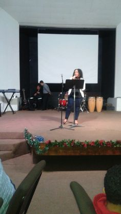 Annie giving a testimony and sang songs during New Year's talent show.