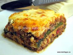 Zucchini Moussaka: Moussaka usually is made with slices of fried eggplant layered between an aromatic meat sauce and topped with a creamy Bechamel Sauce.