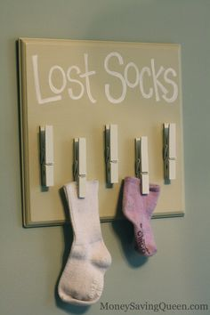 With 3 males in my house, we have tons of socks...I think this is my next craft project.  Looks super easy!  DIY: Laundry Organization with a 'Lost Socks' Sign