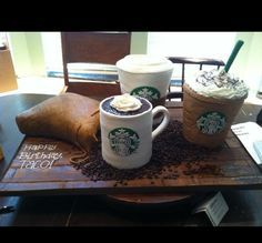 Starbucks Cake  Starbucks Cake This is a large Starbucks cake which includes 4 individual cakes(3 cups and a bag of coffee beans. Everything was made by