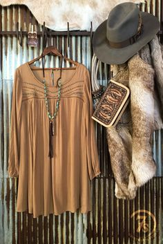 The Laurel- Camel tan embellished dress. Rich metallic beaded pattern. Long sleeve. Elastic gathered cuffs. Flowy. Gathered above the chest. Three back buttons. Good length. Generous fit. Tailored fit thru the shoulders.