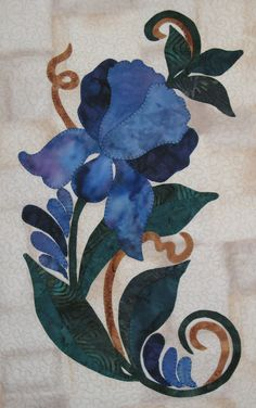 Written by @Marsha Penner Penner Myrum the previous pinner:  Closeup of blue iris.  This is my design.  I gave this to my hair dresser for a xmas gift.  If you don't have the perfect fabric, paint it.  Some of my flower petals have been painted with fabric dye to get just the right color.