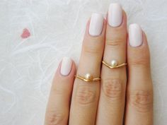 Hey, I found this really awesome Etsy listing at https://www.etsy.com/listing/155471778/pearl-knuckle-ring-gold-filled-knuckle
