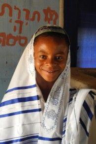 Igbo Jews of Abuja: Yehuda is wearing a new tallit sent from Israel.