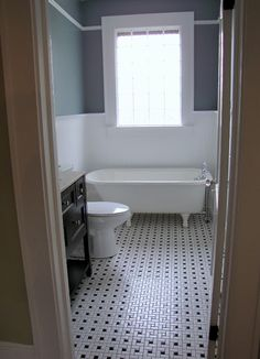 blue color in bathroom, to juxtapose white; also like the bathroom tile...House Hunting Tour :: 1923 Craftsman Bungalow