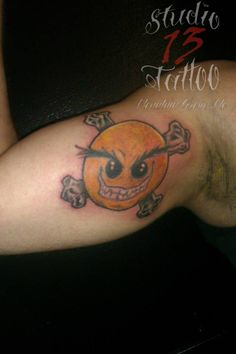 #crossbones #smiley #game #color #tattoo #studio13tattoomo