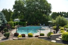 landscaping around fences | Pools | Landscaping Buffalo NY | Woodstream Nurseries | Landscaping ...