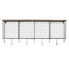 Wood wall shelf with openwork iron cubbies.Product: Wall shelfConstruction Material: Iron and woodColor: