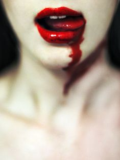 This is supposed to be vampire-style makeup, so the blood is fake. Still, if I didn't have that knowledge, I'd hand her a box of Kleenex and ask her how she cut her lip so deep.