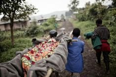 Neighbours carry a pregnant woman on bamboo stretcher to nearest hospital 8 hours away ©Giulio Di Sturco
