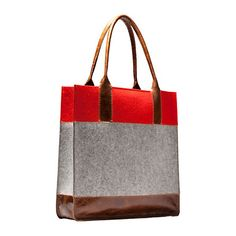 By Graf and Lantz and available from Terrain at shopterrain.com this tote is both classic and modern with its color-blocked leather and wool.
