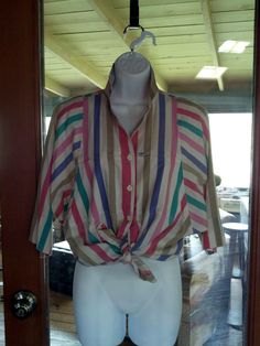 awesome 80s button down. you can't tell from the picture but it has really intense dolman sleeves that narrow to the smallest holes.