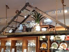 Pottery Barn Display that is really cool.   Three old ladders put together.