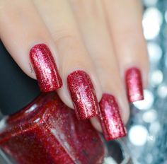 Cherry Luxe is a beautifully stunning, fun, and festively rich red nail polish that's absolutely perfect for the holidays!  Cherry Luxe is part of a set of 6 new holiday themed Precious Metals polishes that take advantage of our Precious Metals formula for an incredibly ornamental-like finish!  Not only is Cherry Luxe stuffed with an assortment of ultra thin metallic flakes for incredible shine, it's also accented with just the right amount of holographic magic to put a smile on your face…
