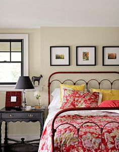 An iron bed from Sundance, plus a Pottery Barn quilt, offers a hit of color in a guest room.