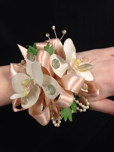 All Seasons Floral- orchid wrist corsage with pearl strands and plenty of bling