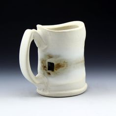Shadow May is amazing.  Sculptural stoneware mug, White matte glaze with soft glass and seashells, Cone 6 oxidation