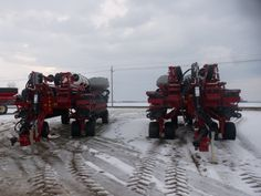2 32 row CaseIH  1265 Early Riser corn planters.Right around $400,000 of new corn planter sitting here