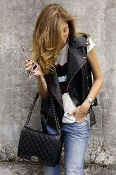 leather vest and white tee