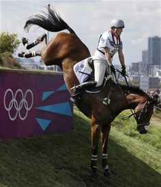 Zara Phillips of Great Britain rides High Kingdom as she competes in the equestrian eventing cross-country phase at Greenwich Park, at the 2012 Summer Olympics, Monday, July 30, 2012, in London. (AP Photo/Ng Han Guan)