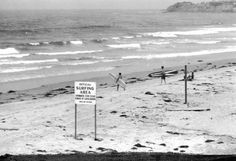 """SURF'S UP!!! Another gem from LIFE Magazine in 1961, this photograph shows the """"OFFICIAL SURFING AREA"""" at Malibu Beach, near Los Angeles. Within a year or so, the surfing craze would hit the nation with a vengeance."""