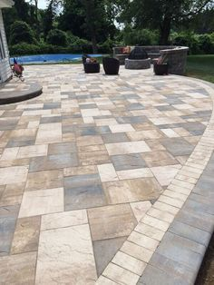 What a beautiful patio created by Artistic Pavers with Cambridge Pavingstones with ArmorTec. Let Cambridge Pavingstones help you create your dream backyard oasis.