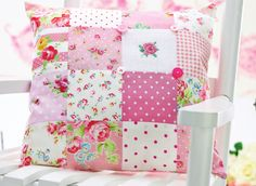 Create a beautiful patchwork cushion with floral prints and cross-stitch detailing