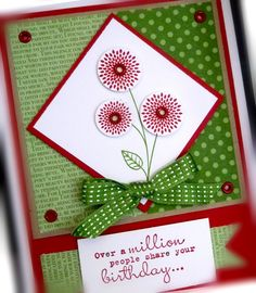 Stamps: World Treasures, One in a Million  Paper: Gumball Green, Real Red, Crumb Cake, Whisper White, In Color DSP  Ink: Real Red, Gumball Green  Accessories: stitched satin ribbon, eyelets  Tools:  Crop-a-dile, Cricle punches, dimensionals