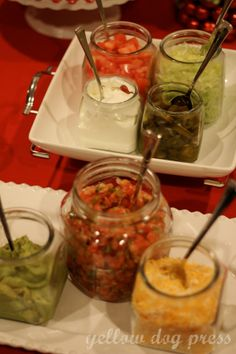 Taco Bar Party: Condiments in mason jars (and put them in ice to keep cool!)