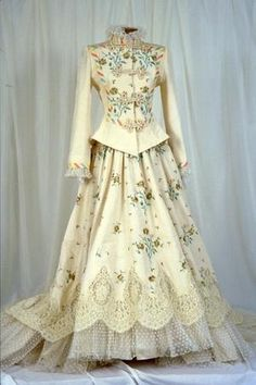Victor costa walks through history pulling elements of 1890's. The detail lace embroidered fabric are amazing in this wedding dress. The jacket and skirt all popular in 1890 fashion.