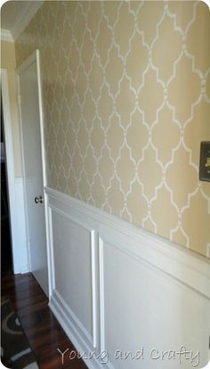 stenciling over molding. not in love with the color but fun idea for hallway upstairs.
