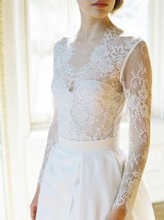 If you've been looking for something with long sleeves, beautiful lace detailing, a little Victorian and a little sexy you have definitely come to the right pla