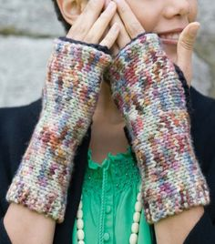 Free Knitting Pattern for Easy Motley Mitts - Fingerless mitts knit flat on straight needles and shaped with short rows. Designed for multi-color yarn by Lisa Shroyer. Rated easy by Ravelrers.