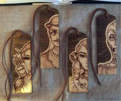 I want to show you my pyrographed bookmarks 📖   They are made of plywood. I designed and burned 4 patterns for different novels: fantasy, crime fiction, science-fiction and romance. Bookmarks are stained and varnished, I also added a suede strap.  pyrography, bookmarks, fantasy,