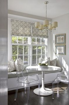 Gray breakfast nook, white trim, lucite chairs, built in bench by kathleen
