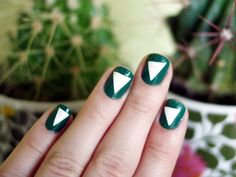 White Triangles Nails  The Dainty Squid created this simple graphic look by cutting Scotch tape into triangles and sticking them over painted nails, then painting another coat over the first one. Think of all the different shapes you can try…