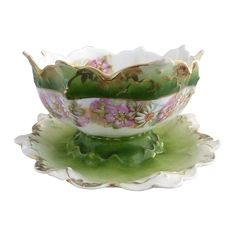 Antique porcelain sauce boat that is hand enameled and made in Austria.